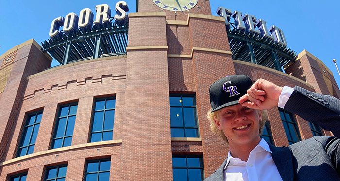 Case Williams is pictured outside of Denver's Coors Field, the home field of the Colorado Rockies.